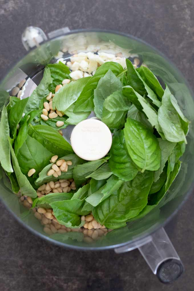 Easy Vegan Pesto - ingredients inside the bowl of a food processor