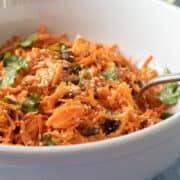 vegan carrot salad in a white bowl