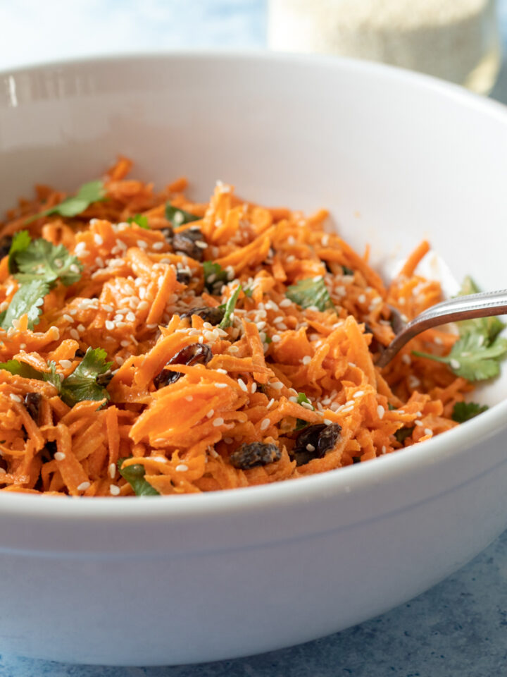 vegan carrot salad in a white bowl