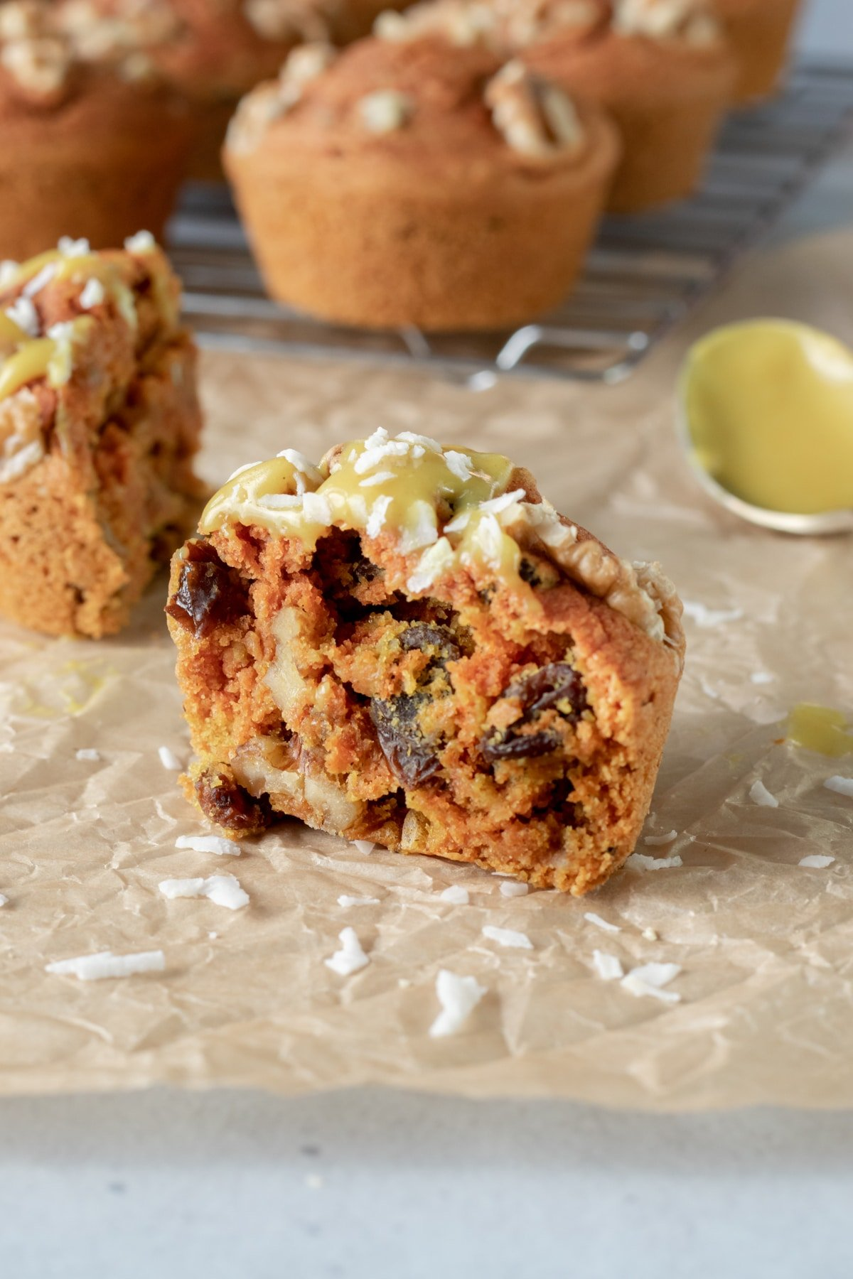 view of the inside of a muffin, with raisins and walnuts