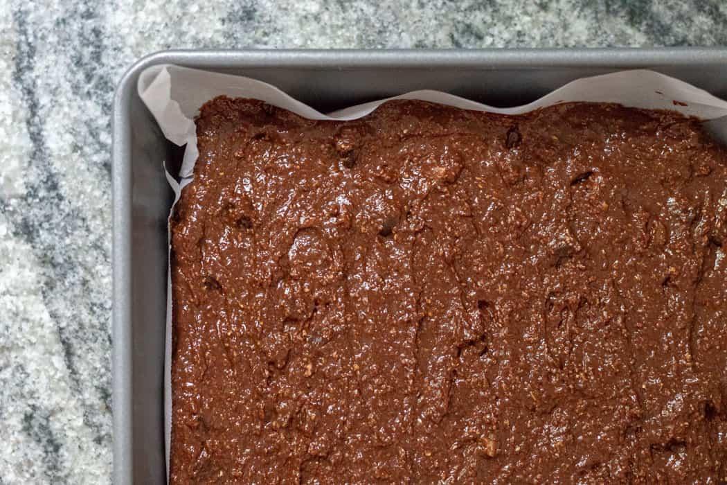 raw brownie batter in pan
