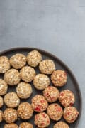 popped sorghum balls on a black plate