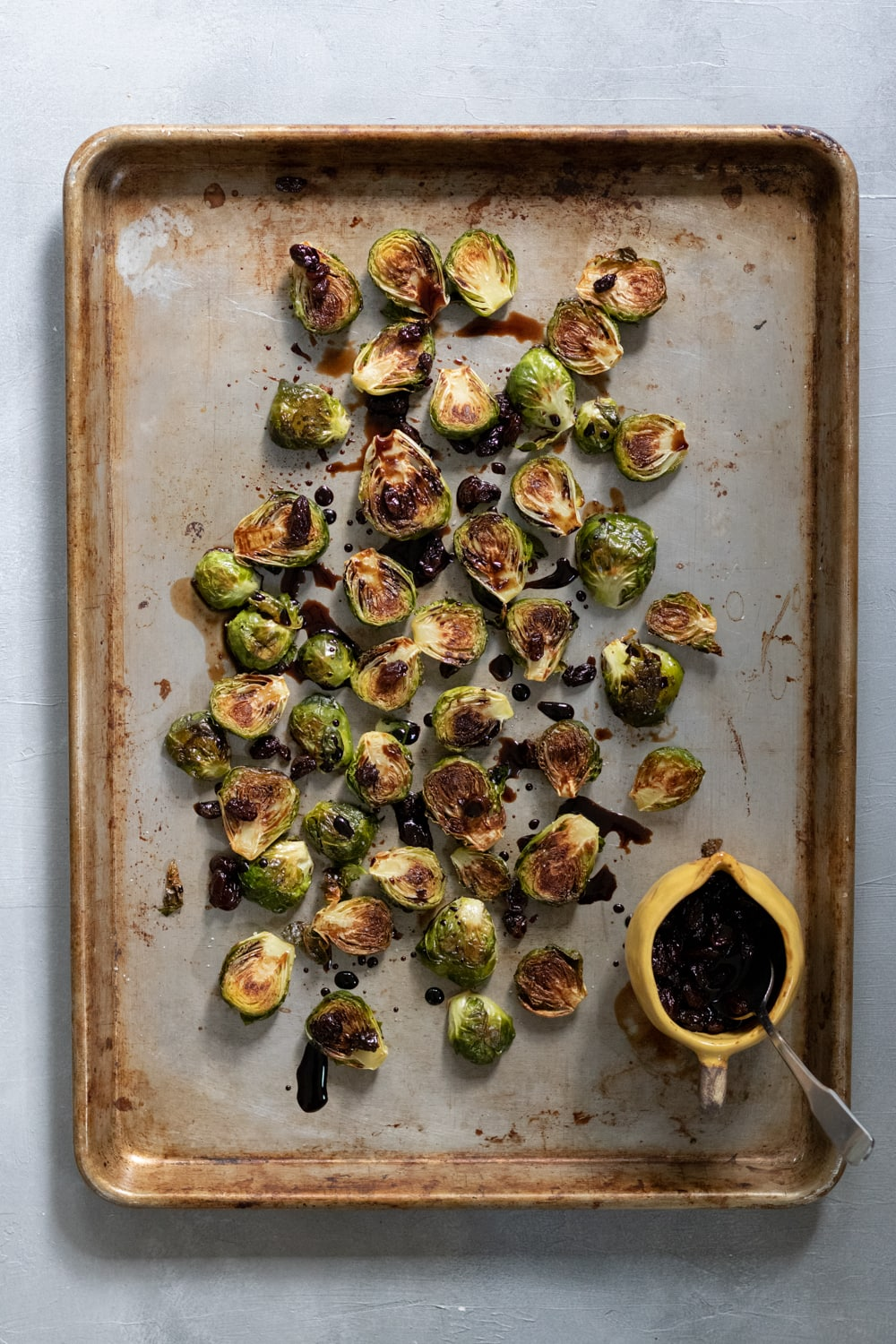 roasted brussels sprouts and balsamic glaze on a sheet pan
