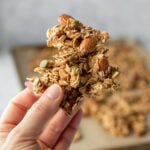 hand holding a big cluster of granola