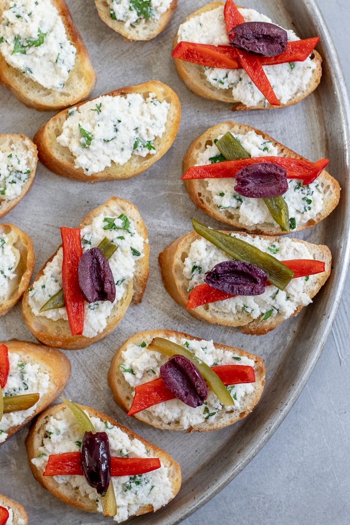 overhead view of crostini on a tray