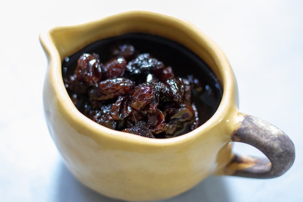 balsamic raisin reduction in a small cup