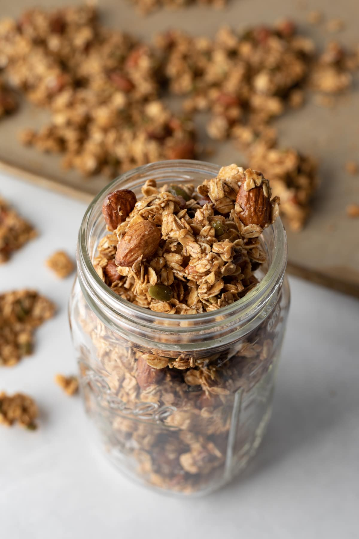 granola in a large jar and on baking sheet