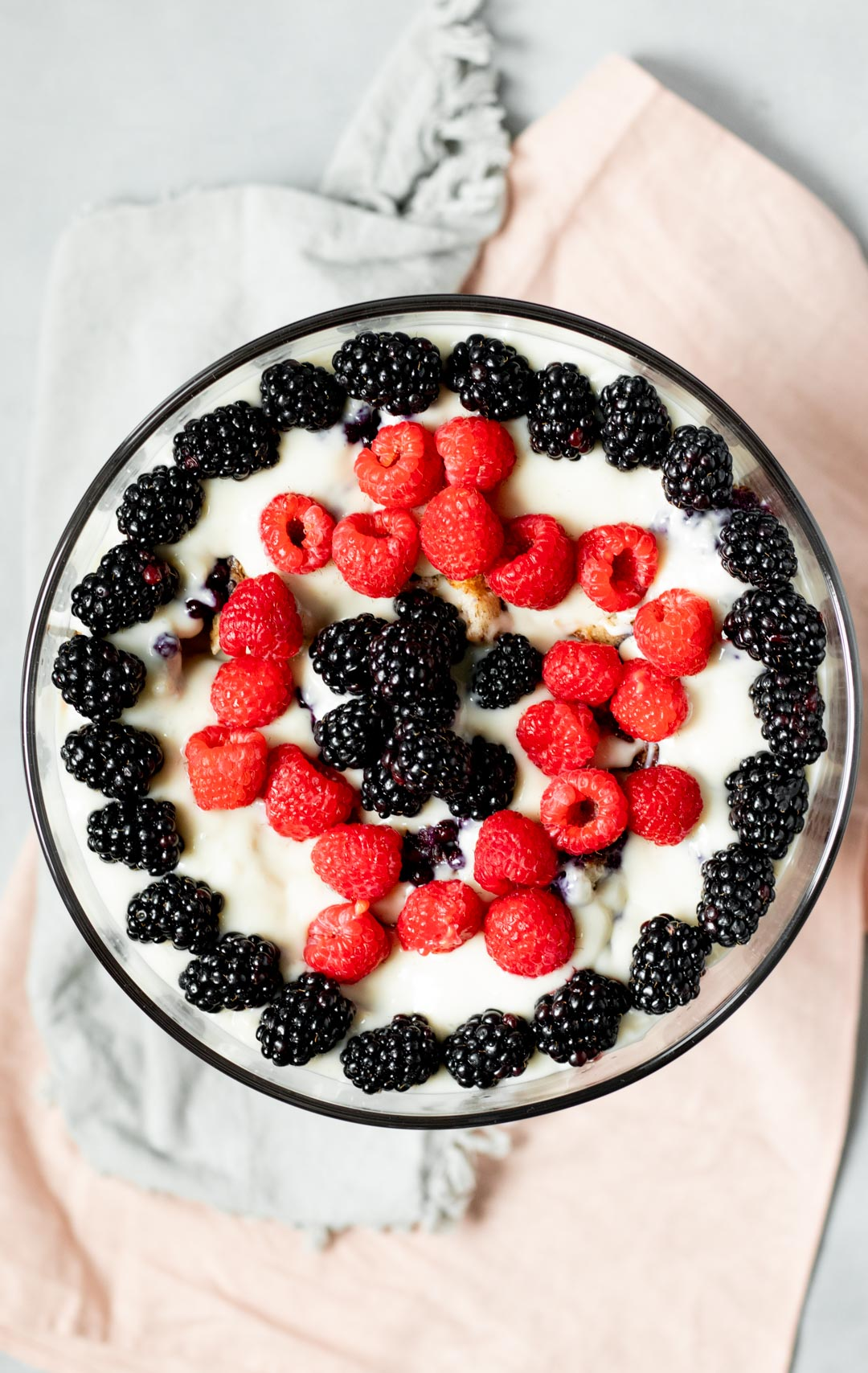 overhead view of vegan trifle topped with blackberries and raspberries