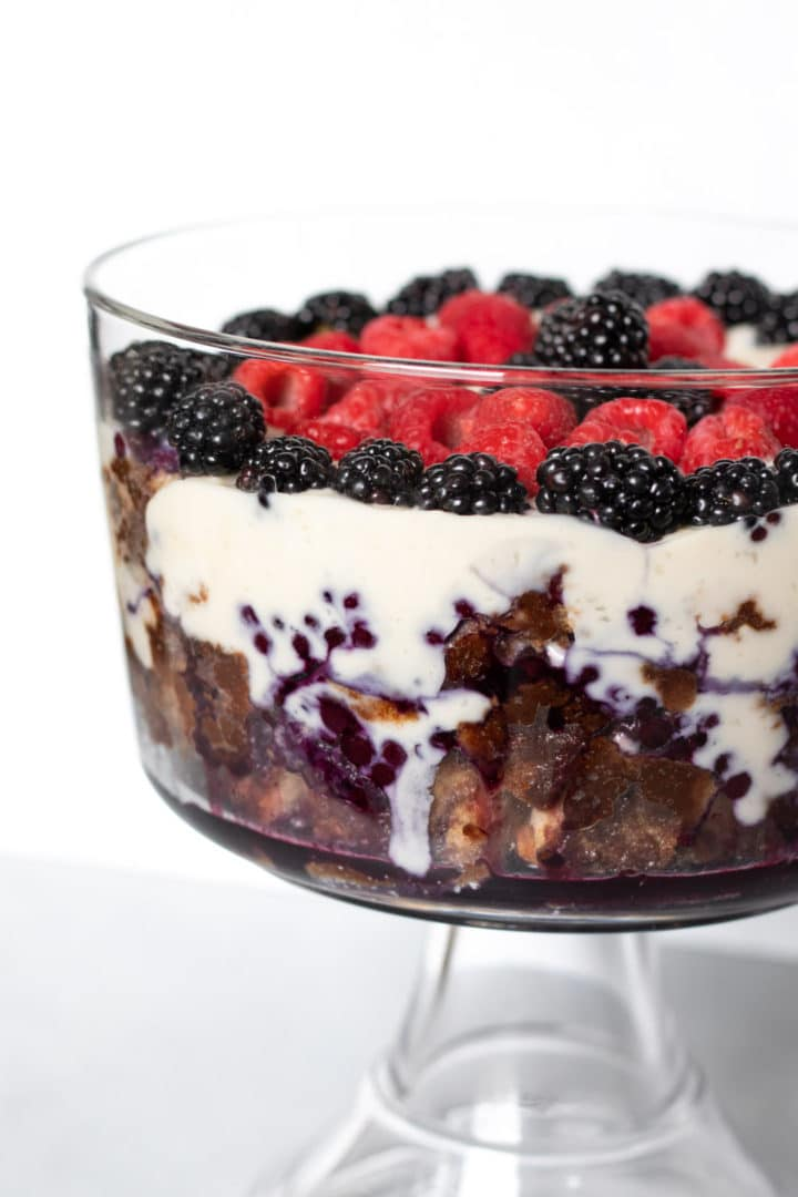 close up showing layers of French toast, pudding, and berry sauce
