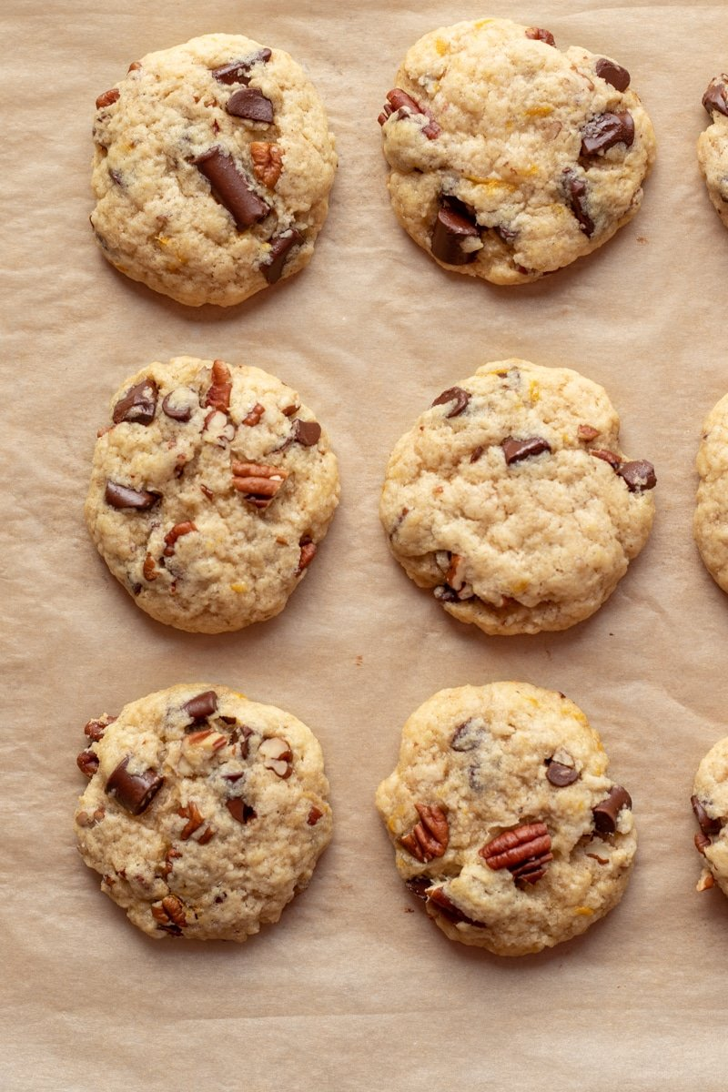 Chocolate Chunk Orange Pecan Cookies on parchment paper