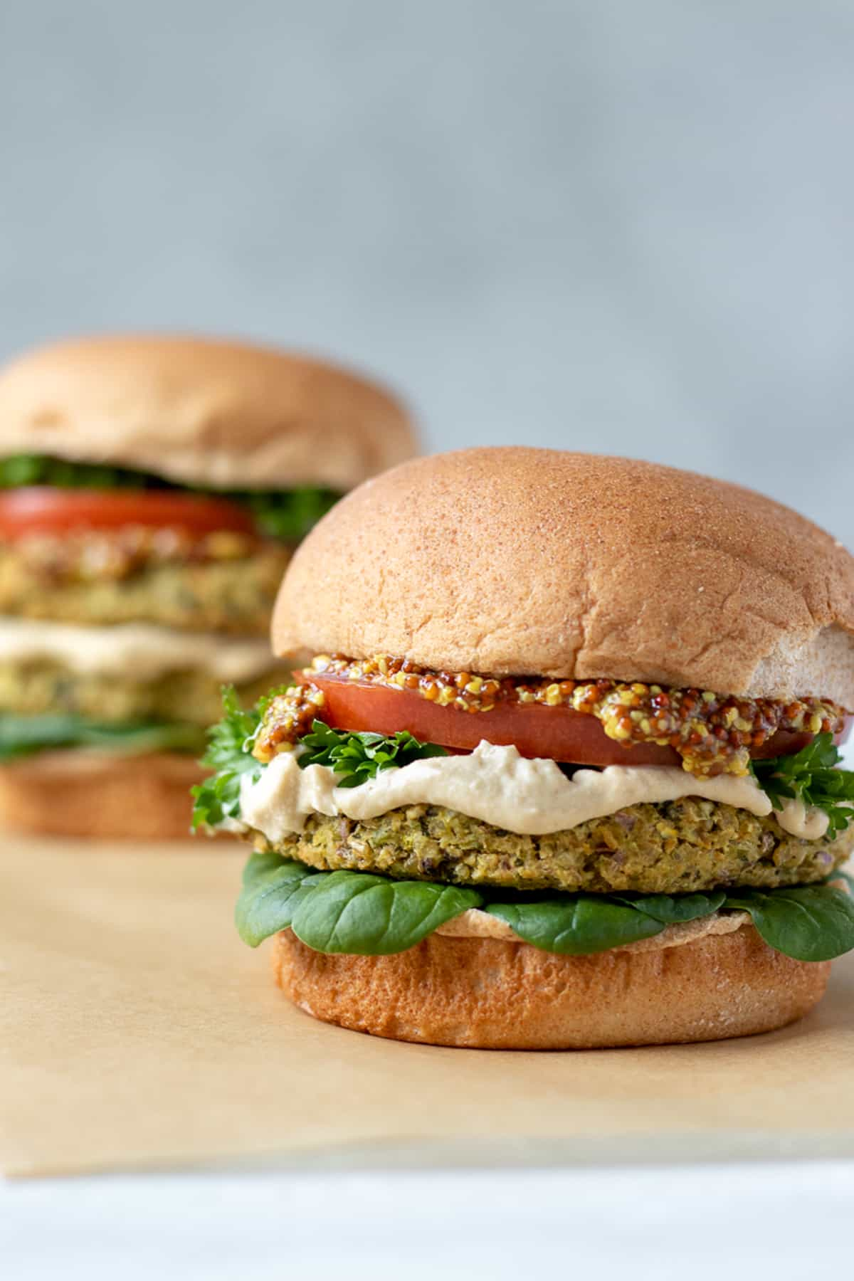 bean burgers on buns loaded with toppings.