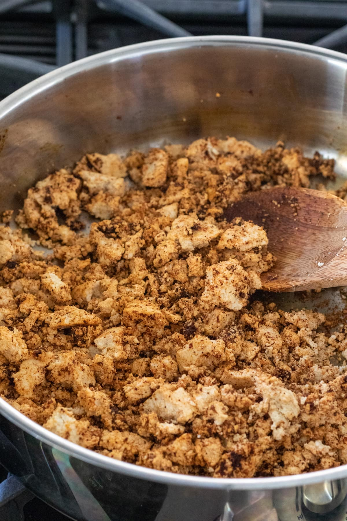beginning stages of cooking tofu with spices in a pan