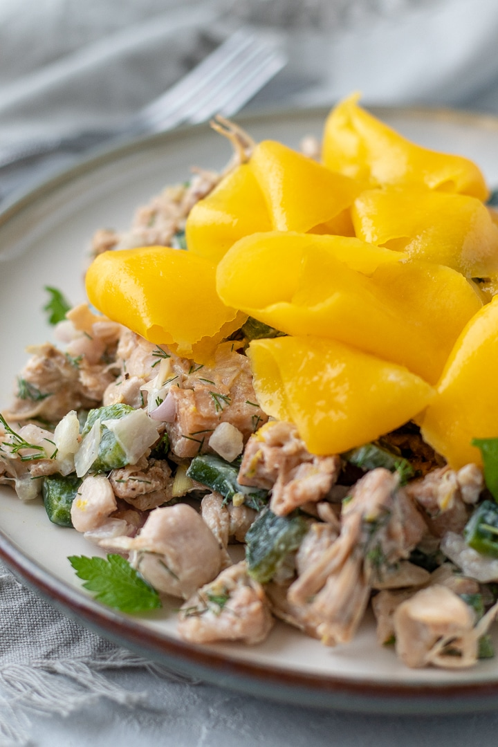 Jackfruit salad with dill, shallot and poblano pepper topped with ribbons of fresh mango