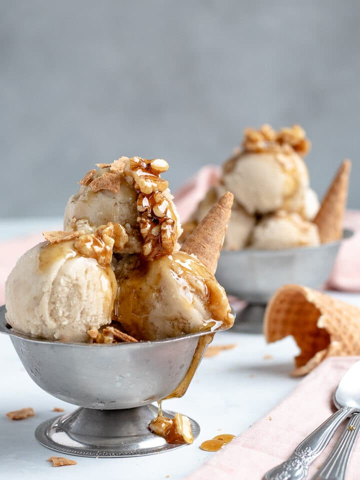 Banana Nice Cream topped with wet walnuts and pieces of sugar cone