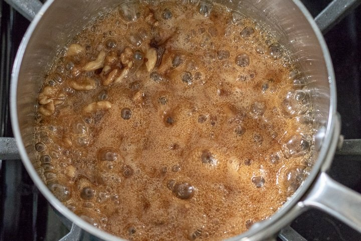 wet walnut mixture cooking in a sauce pan