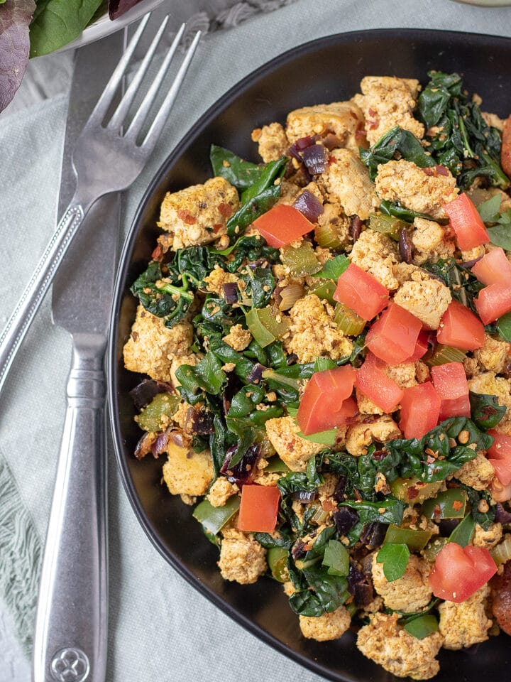 Cajun Tofu Scramble topped with chopped tomato
