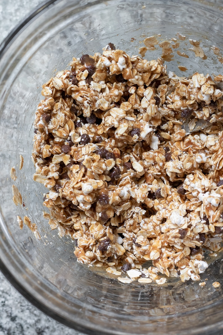 Oats, popped sorghum, and chocolate chips coated in brown rice syrup and almond butter mixture