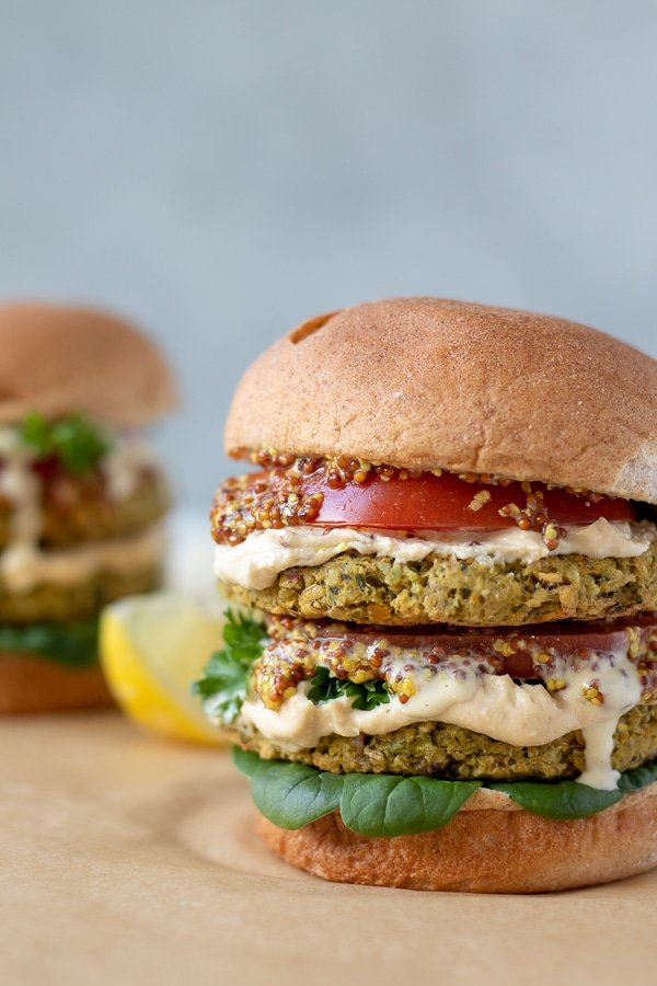 colorful chickpea burgers stacked on a bun
