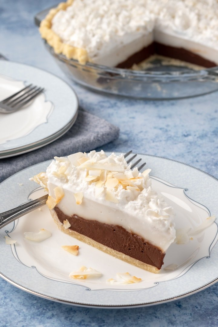 a slice of chocolate haupia pie on a plate