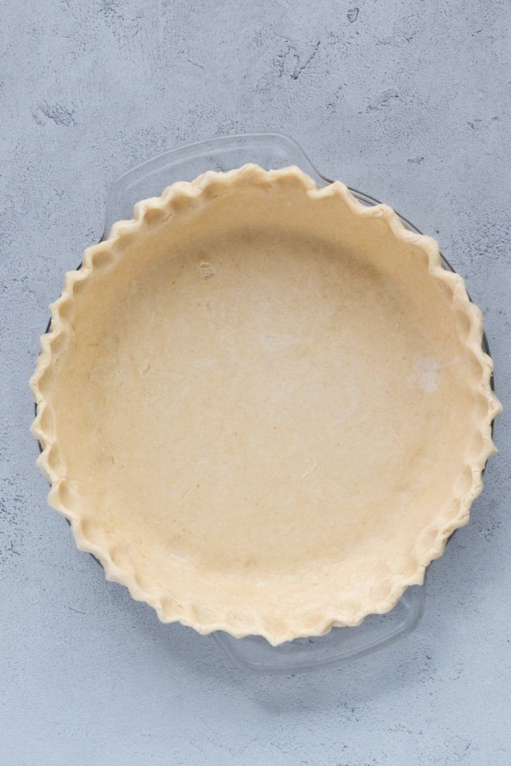 unbaked pie crust in a pie plate