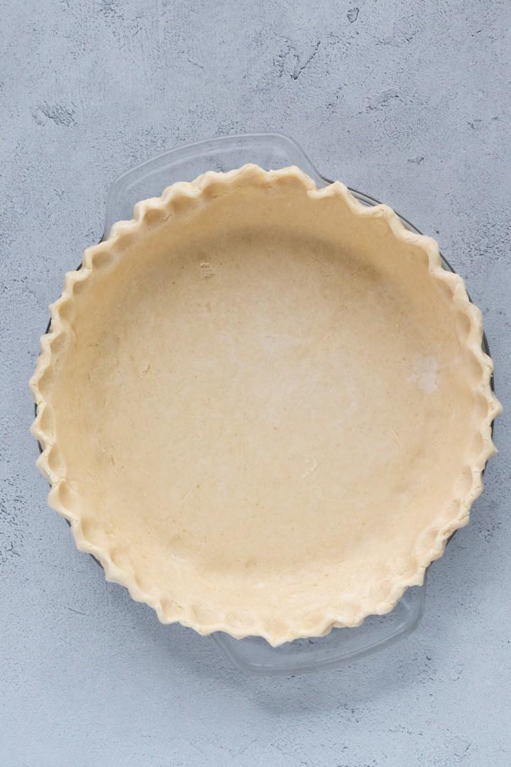 unbaked pie crust in a pie plate