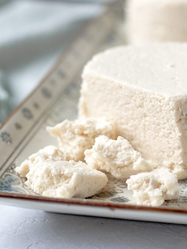 crumbled almond cheese on a platter