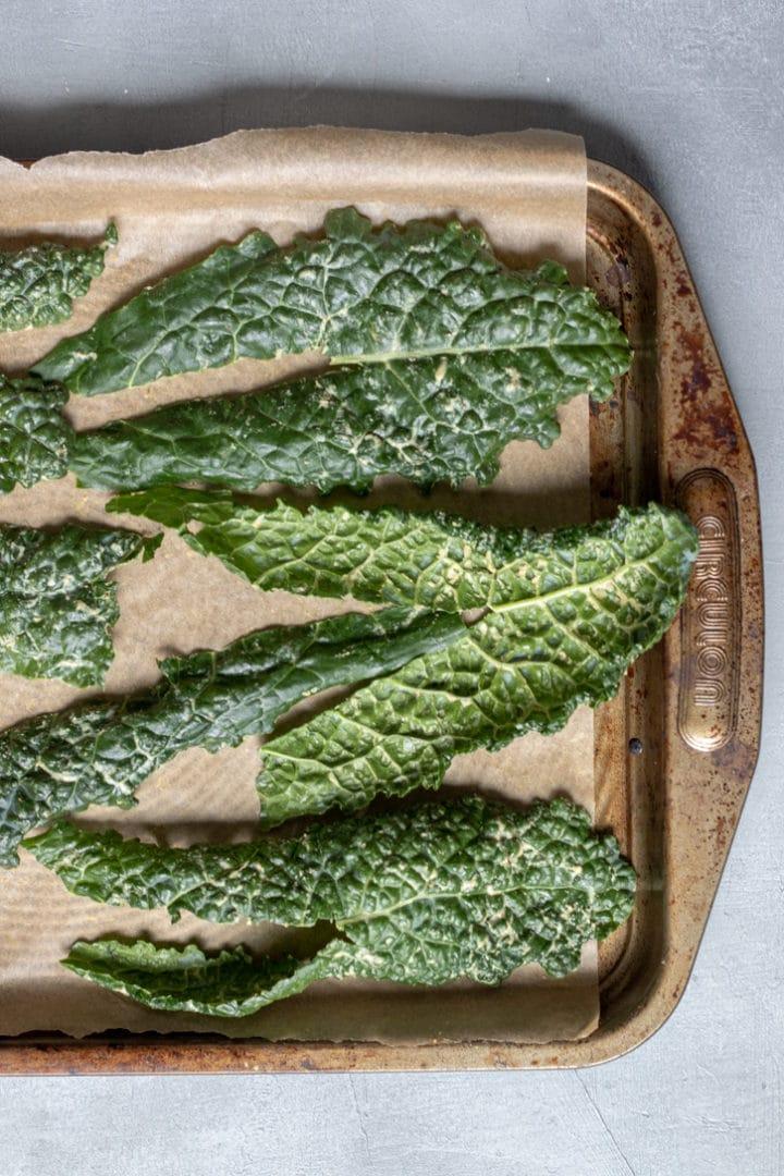 kale leaves on a baking sheet