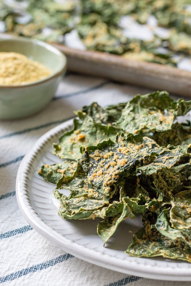 oil-free kale chips stacked on a plate