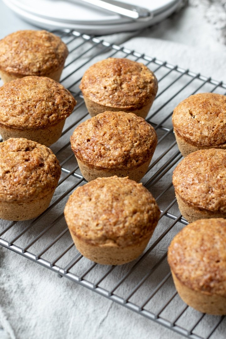 coconut milk muffins on a cooking rack