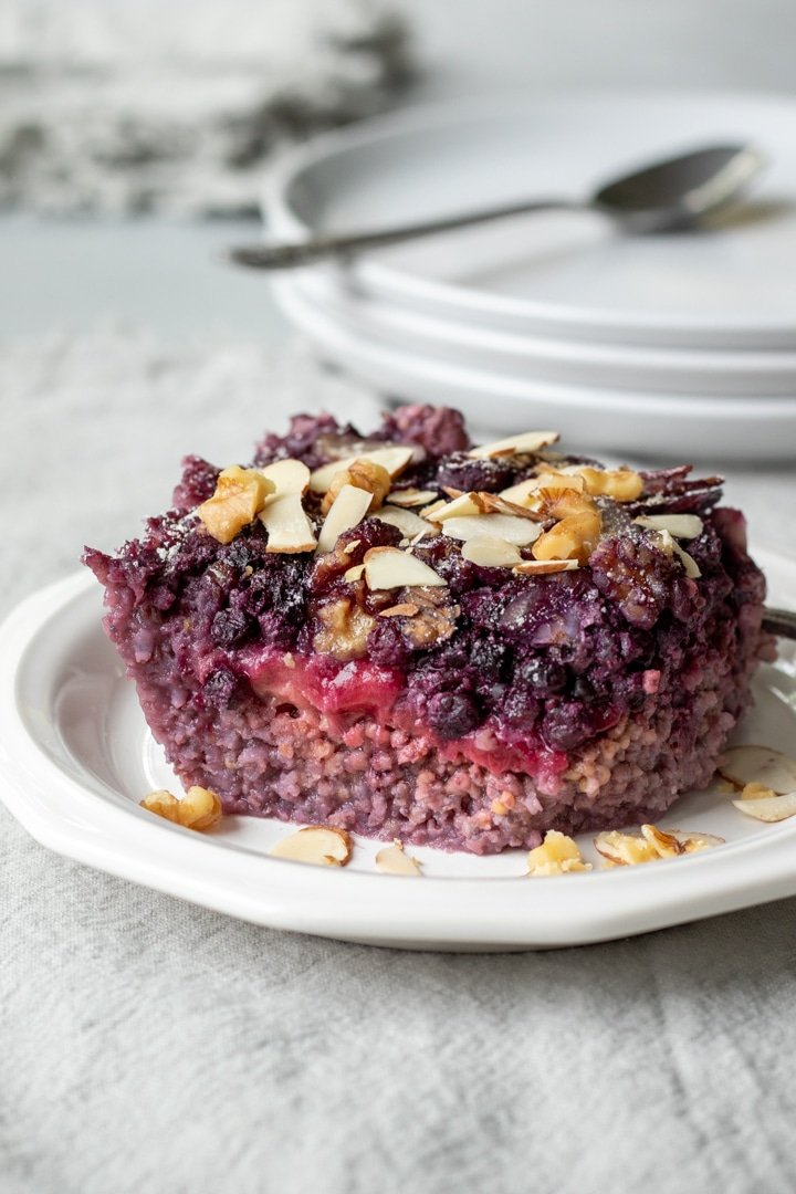 a single slice of millet breakfast bake with berries