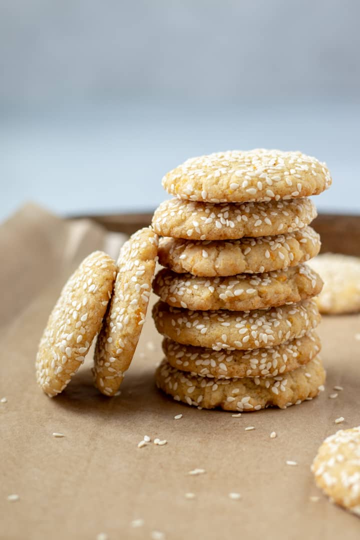 a stack of Tahini Cookies on a baking sheet