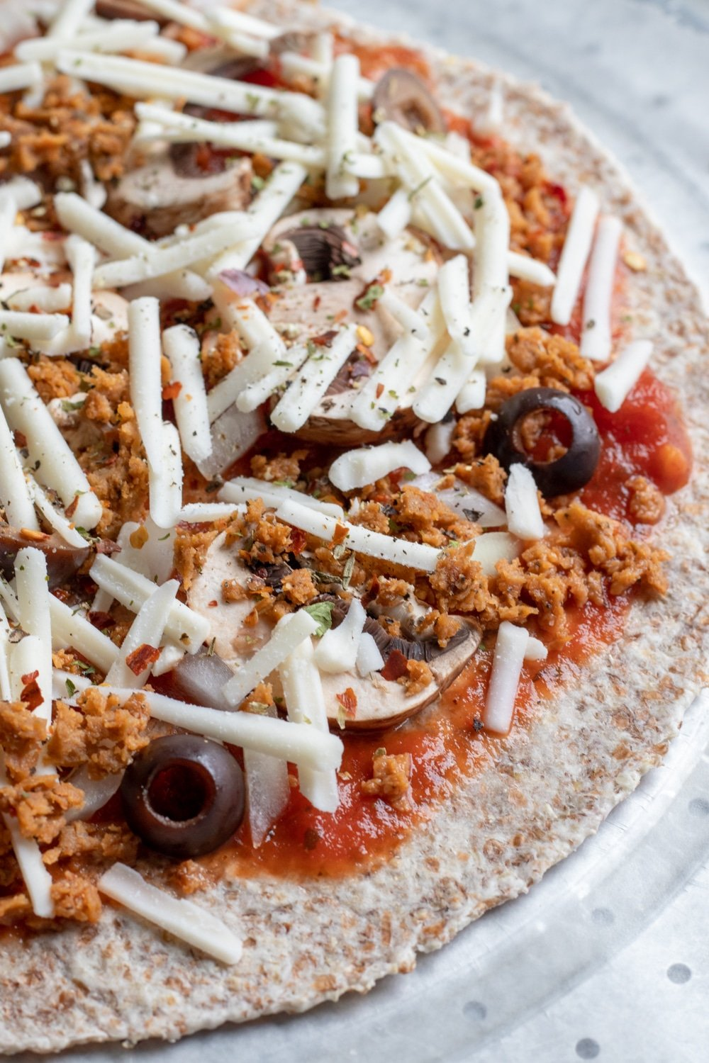 easy vegan pizza prepped, ready to be baked or frozen for later