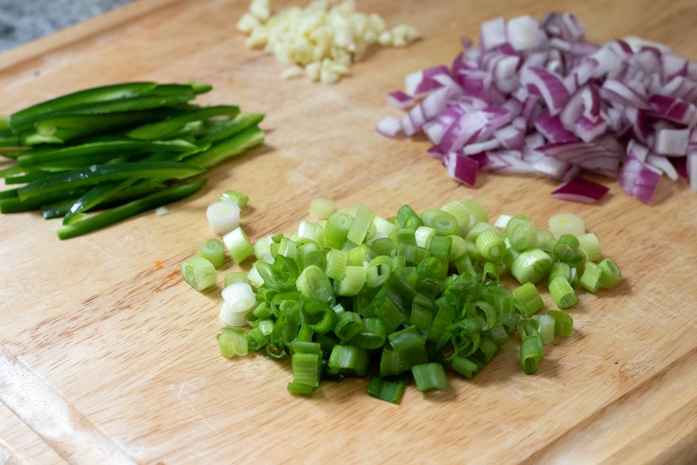 chopped and sliced red onion, jalapeños, green onion and garlic