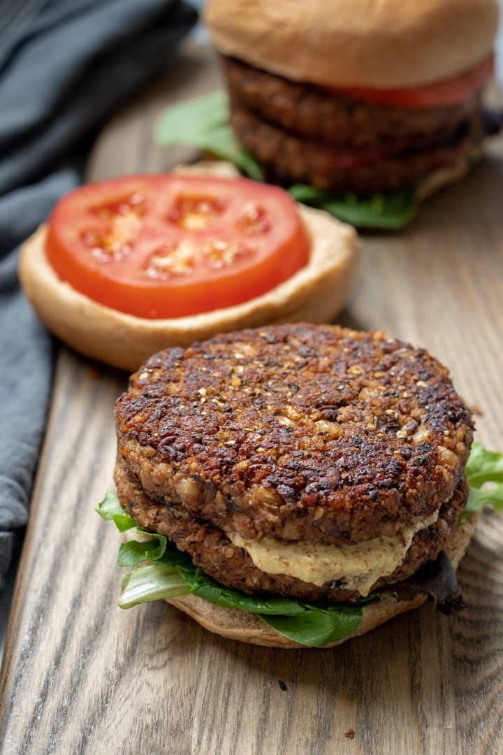 Vegan Mushroom-Barley Burger on a cutting board, with bun and fixings