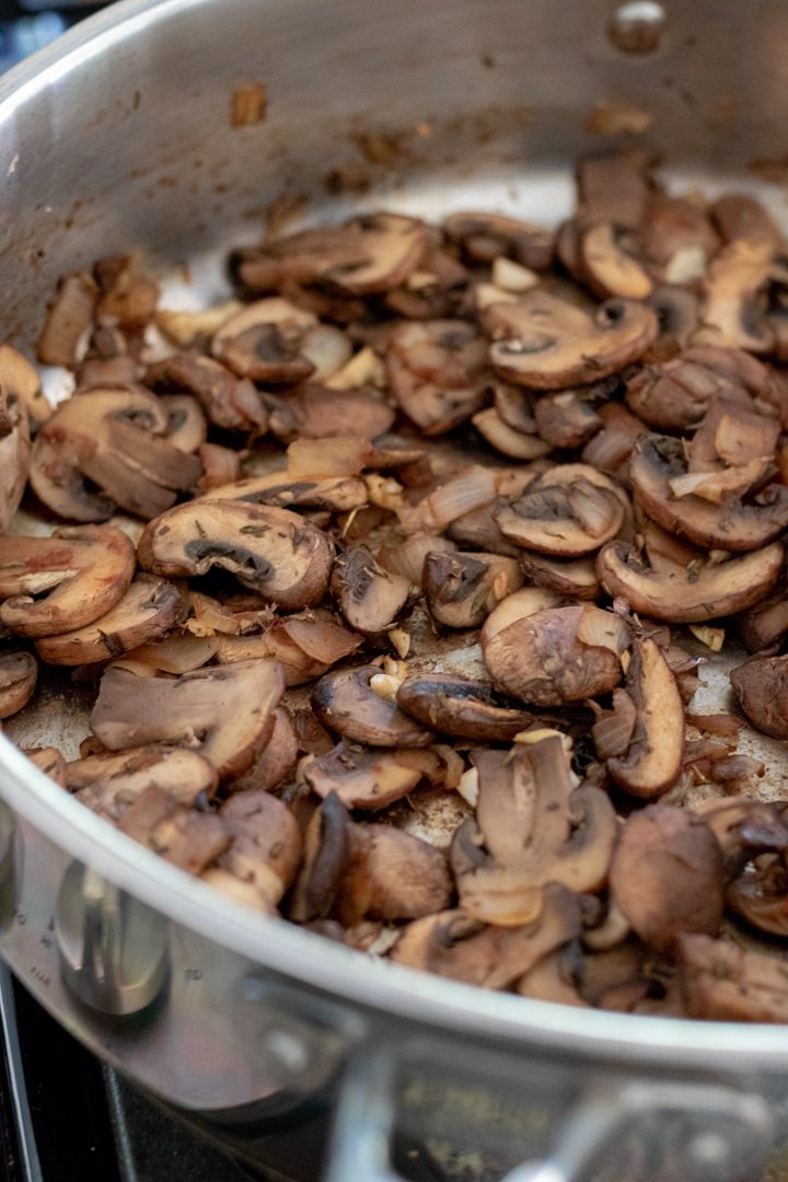 mushrooms sautéing in a pan
