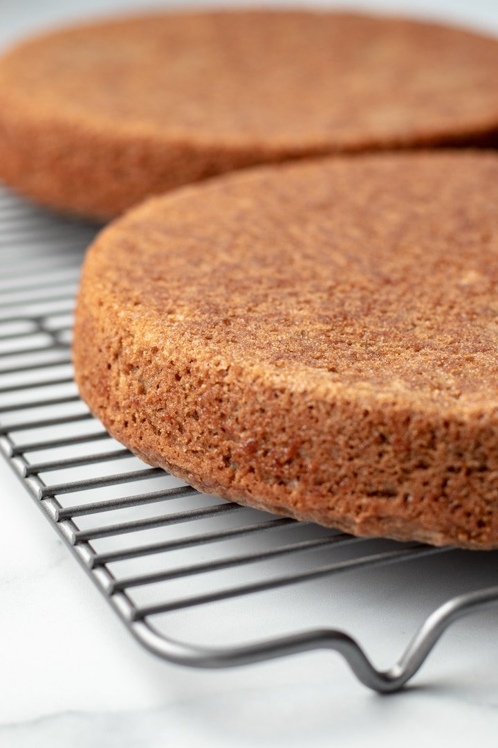 two cake layers on a cooling rack