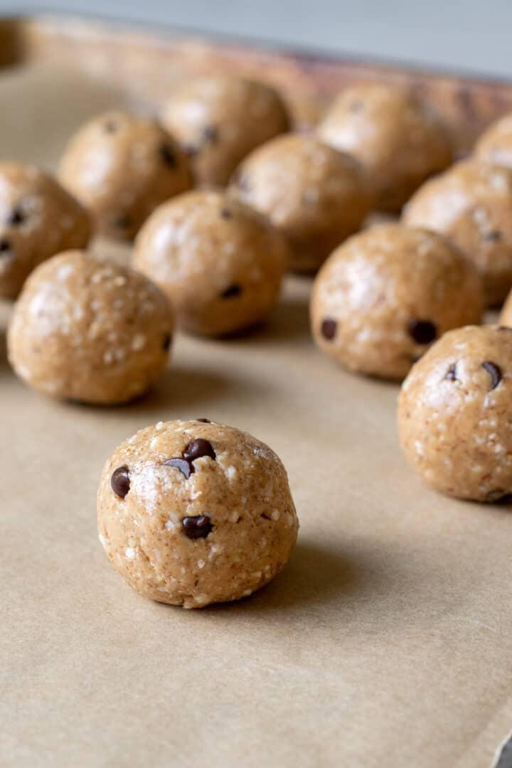 vegan protein balls on parchment paper