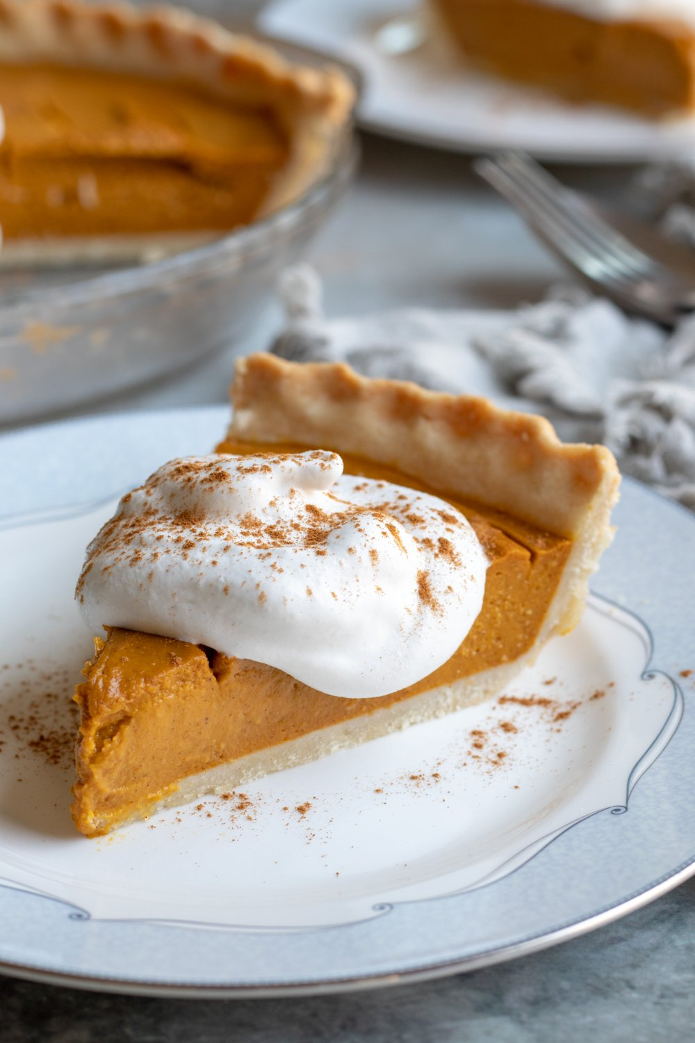a slice of healthy and easy vegan pumpkin pie on a small plate.