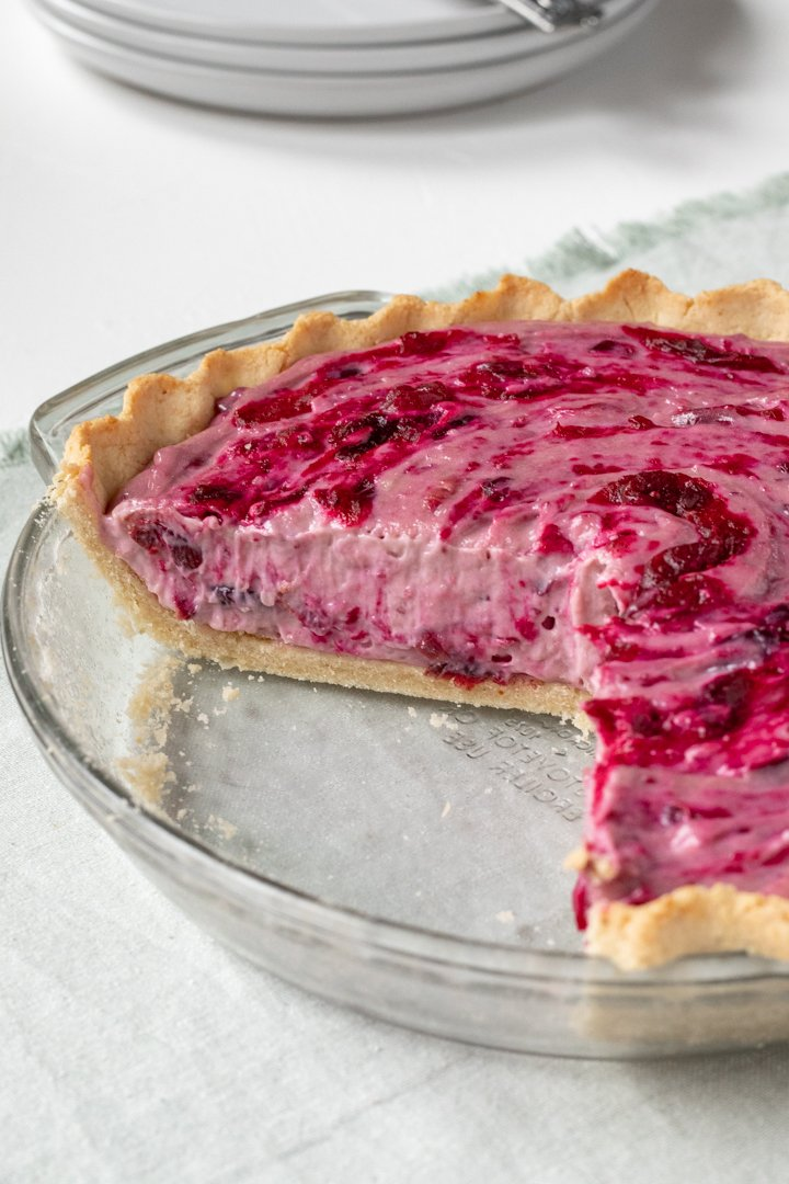 vegan cranberry cream pie in a glass pie plate