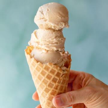 three scoops of Vegan Vanilla-Maple Ice Cream in a waffle cone