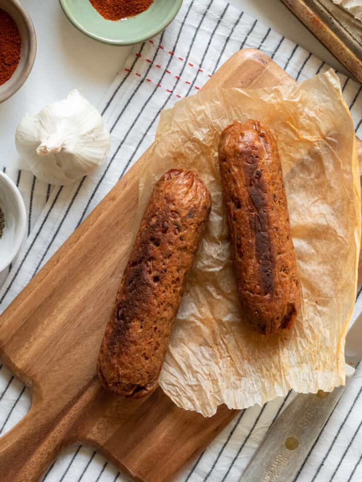 spicy vegan sausage on a cutting board.