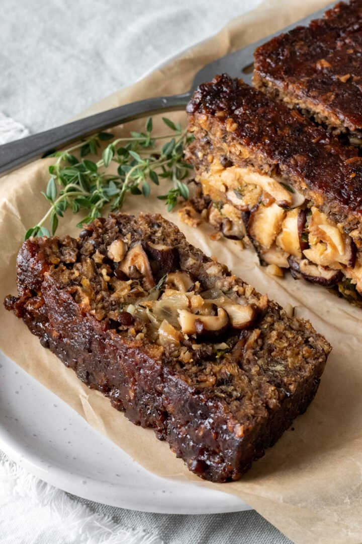Beyond Meat loaf on a platter showing the shiitake stuffing inside