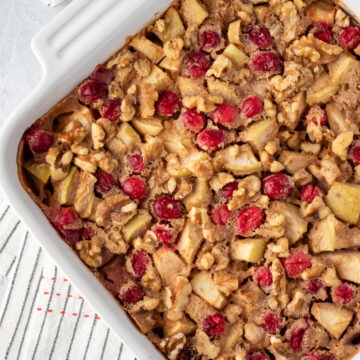 apple cranberry baked oatmeal in a white square baking dish