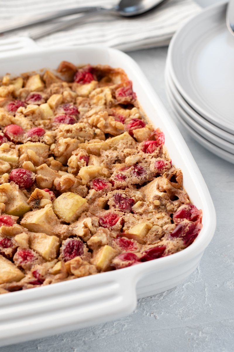 apple cranberry baked oatmeal in a white baking dish