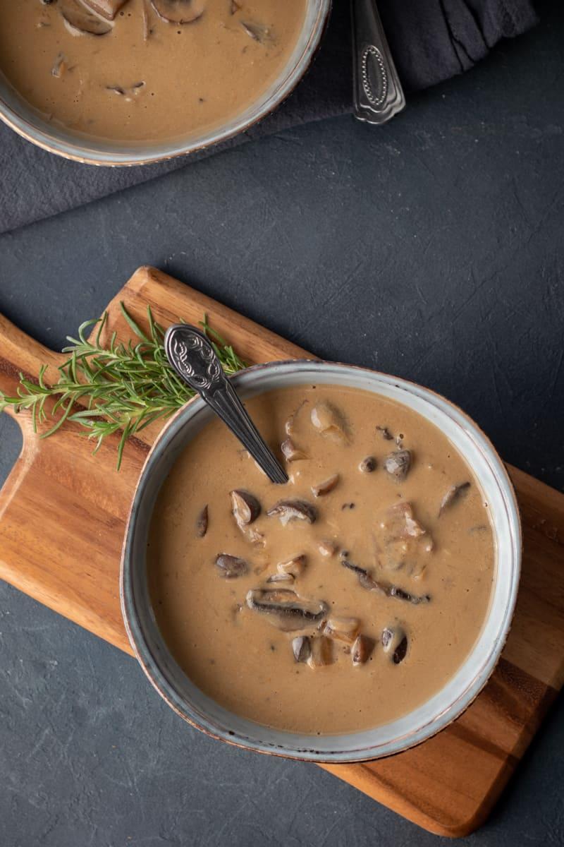 overhead shot of vegan cream of mushroom in bowls