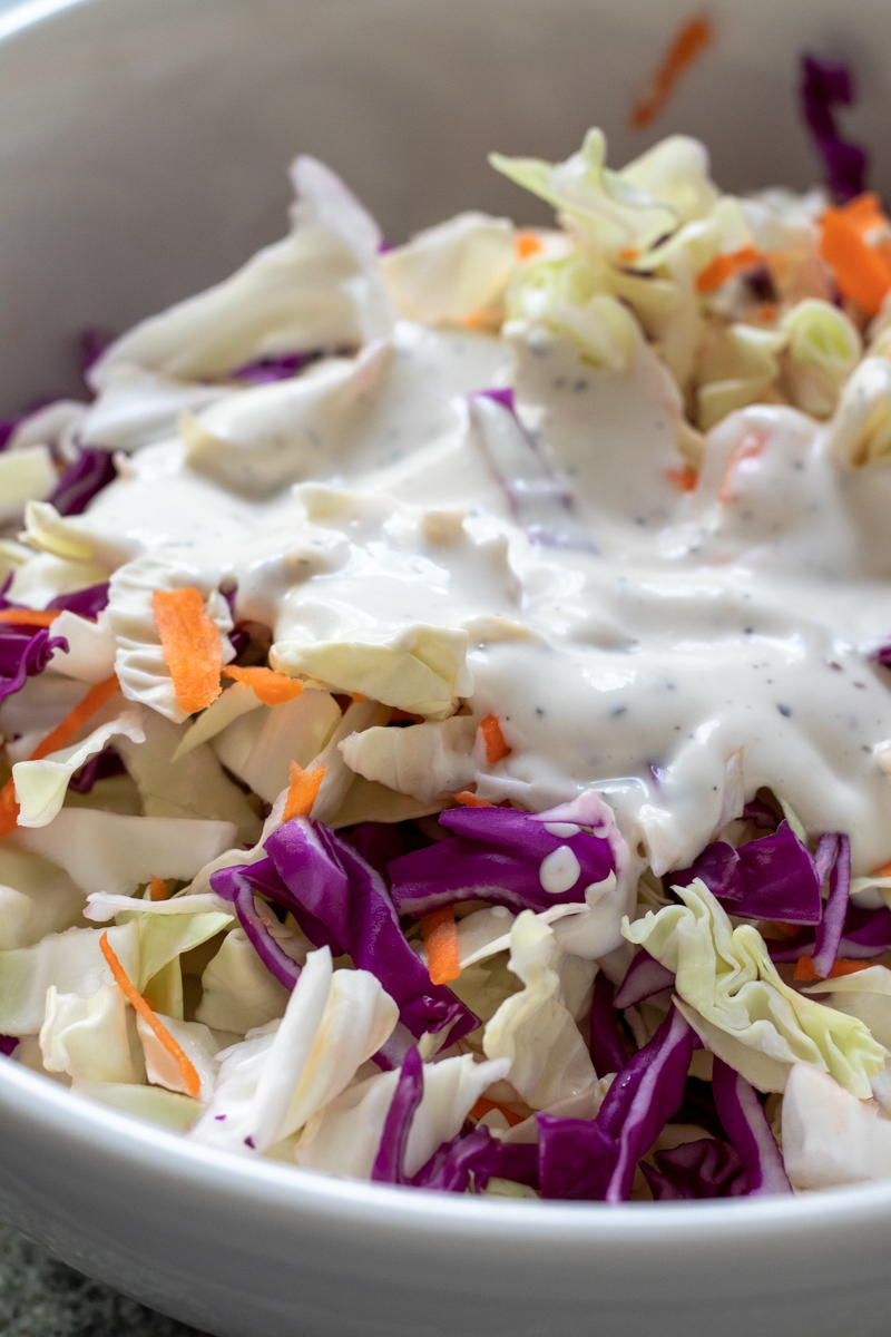cabbage and vegan coleslaw dressing in a bowl