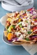 vegan bbq nachos piled on a serving tray