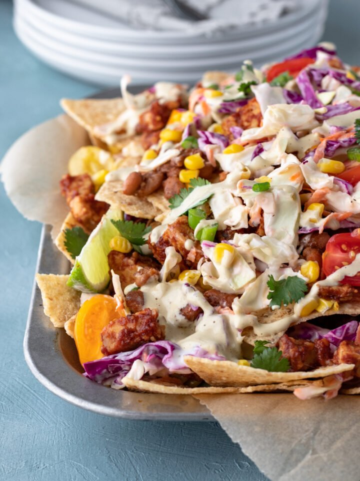 vegan bbq nachos piled on a serving tray