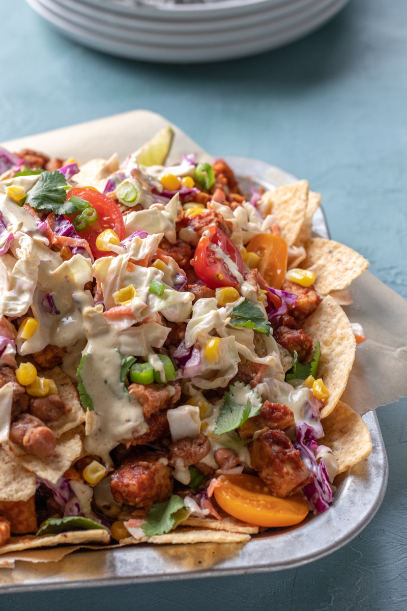loaded vegan nachos with bbq tempeh, coleslaw, and more