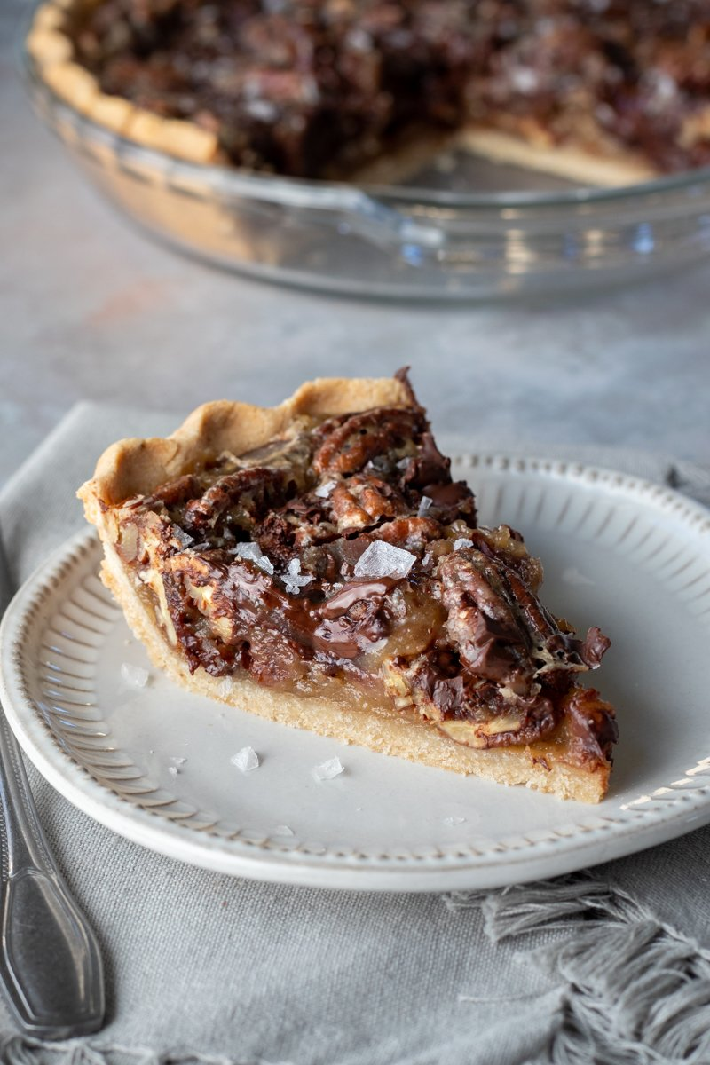 a slice of salted chocolate pecan pie on a plate